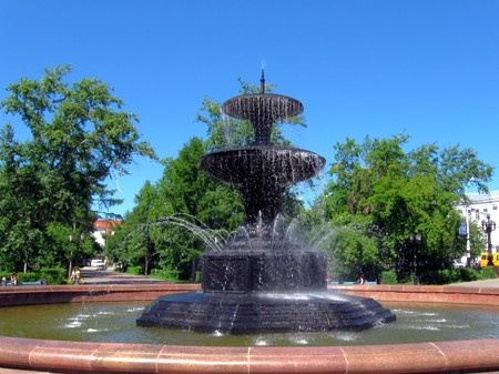 Summer.The old  Fountain in square  in Omsk, Russia photo