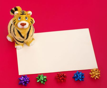 ornamentals: new year card. jolly tiger figurine,form and ornamentals