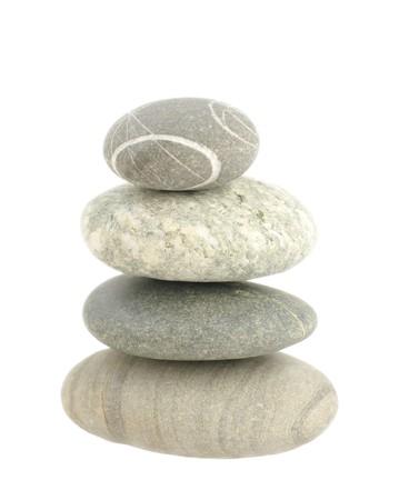 revet pile four grey stones on white isolated