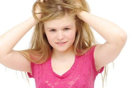 tresses: young blonde woman rumples tresses hair on white  Stock Photo