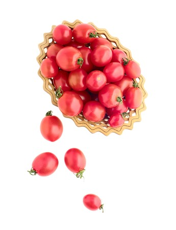 dispersed: tomatos in vase and dispersed top view on white isolated  Stock Photo