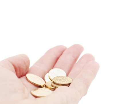 A few copper coins in hand  on white isolated Stock Photo