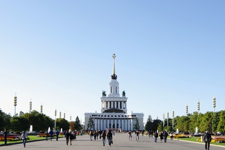 enea: MOSCOW, RUSSIA - SEPTEMBER 16, 2014:  ENEA exhibition center, VDNH, VVC, Alley of fountains  witn people and view of Central pavilion No 1.