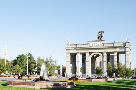 enea: MOSCOW,RUSSIA - SEPTEMBER 16, 2014: ENEA VDNH,VVC,Exhibition center,   main entrance Gate, alley of fountains, walking people. Editorial