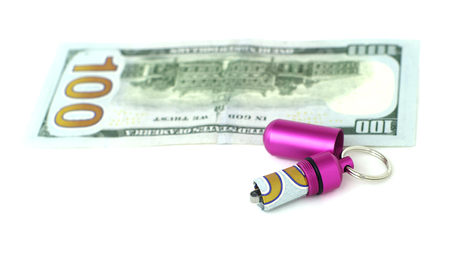 bibelot: waterproof capsule for cash and banknote on white isolated Stock Photo