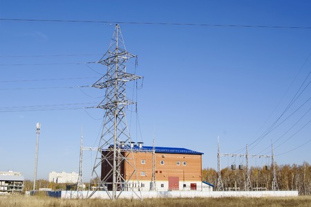 three phase: towers and wires of high voltage transmission lines at substation building