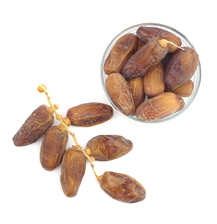 air dried: dried dates on branch and in cup top view Stock Photo