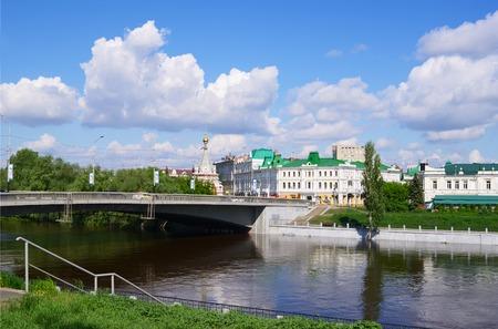 seraphim: Omsk, Russia - May 25, 2015: Summer views of river Om, Jubilee bridge, Seraphimo-Alekseevskaya chapel,  and building of organ hall Editorial