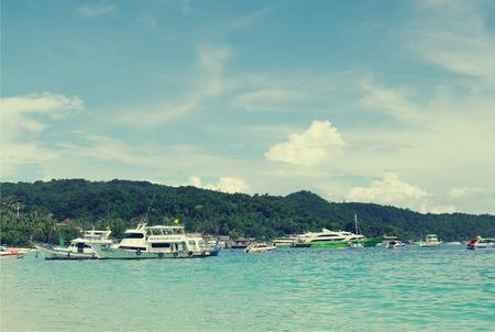 passenger ships: KRABI, THAILAND - OCTOBER 27, 2013: Andaman sea, Ton Sai Bay, Phi Phi Don island,   passenger ships at shore, toned image