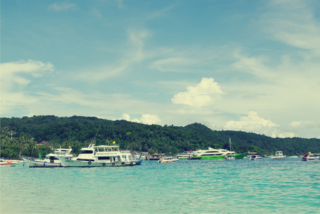 celadon green: KRABI, THAILAND - OCTOBER 27, 2013: Andaman sea, Ton Sai Bay, Phi Phi Don island,   passenger ships at shore, toned image