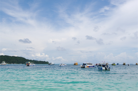 celadon green: Andaman sea, Thailand - October 27, 2013: a lot of floating passenger ships with tourists in open ocean