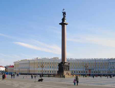 column arch: St.Petersburg, Russia - October 7, 2014: Dvortcovaya square with walking people, views of     Alexander column and General staff building with arch