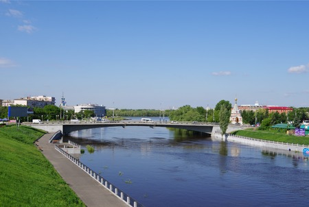 seraphim: Omsk, Russia - May 25, 2015: Summer views of river Om, Jubilee bridge and Seraphimo-Alekseevskaya chapel