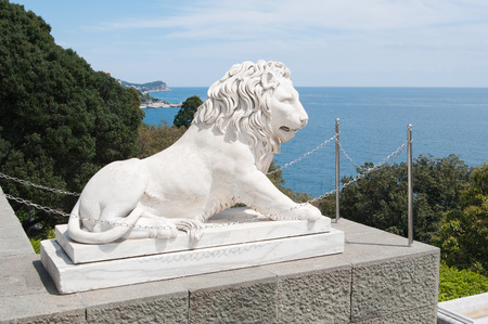 alupka: Alupka, Russia - May 10, 2016: sculpture of marble lion of Vorontsov Palace