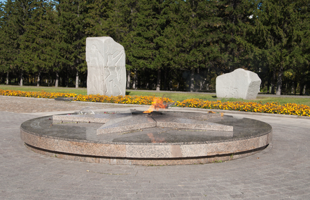 Eternal flame and alley Road of war in Victory Park, Omsk, Russia Stok Fotoğraf