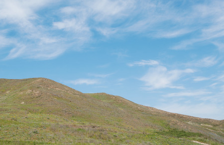 nature background, green hills and blue clouds sky Stok Fotoğraf