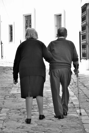 old man walking: Walking old couple Stock Photo