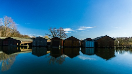 boat houses and calm river