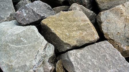 rocks of a harbour breakwater Stok Fotoğraf