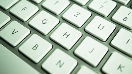metallic keyboard with white keys Stock Photo