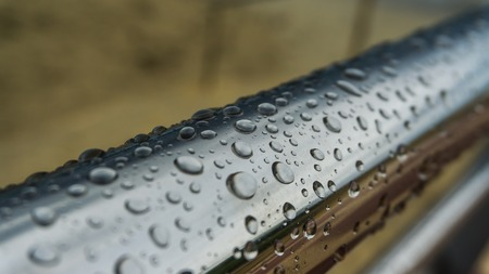 chrome-plated handrail with water drops