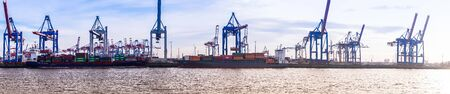 Hamburg, germany - February 2019 Panorama of Hamburg harbor container terminal with cranes, containers and ships
