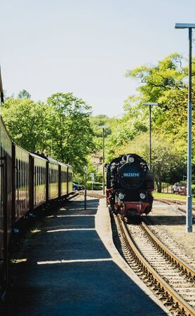 BAD DOBERAN, GERMANY - MAY 13, 2019 - steam locomotive Molli in train station of Bad Doberan
