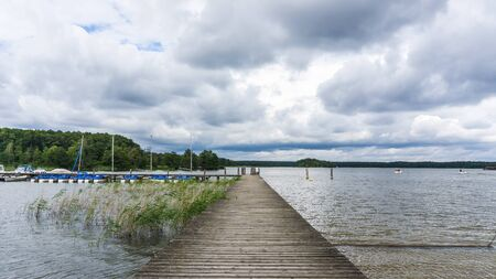 jetty with sailboats at the lake of Rheinsberg
