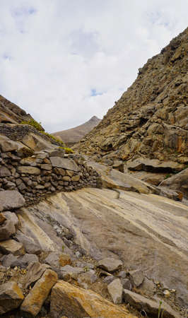 Hiking path in Barranco de las Penitas in the mountains of Fuerteventura
