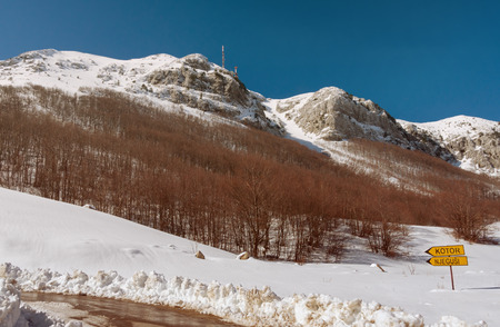 steep cliff sign: National park Lovcen in winter. Road to Kotor city. Montenegro