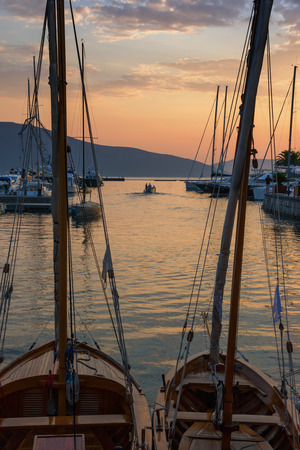 afterglow: Sunset afterglow. Port in Tivat city, Montenegro Stock Photo