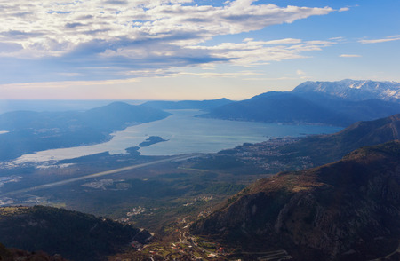birdseye view: Birds-eye view of  Bay of Kotor and Lustica peninsula near Tivat city in the evening. Montenegro