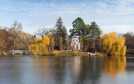 city park pavilion: Upper pond and Pink Pavilion on Island of Anti-Circe in park Sofiyivka National dendrological park of Ukraine.  Uman city, Central Ukraine