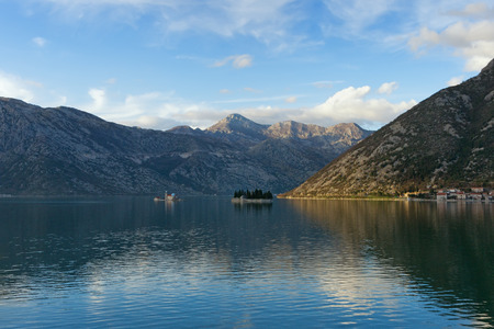 reverberation: Bay of Kotor near Perast city. Island of Our Lady of The Rocks  and Island of Saint George. Montenegro Stock Photo