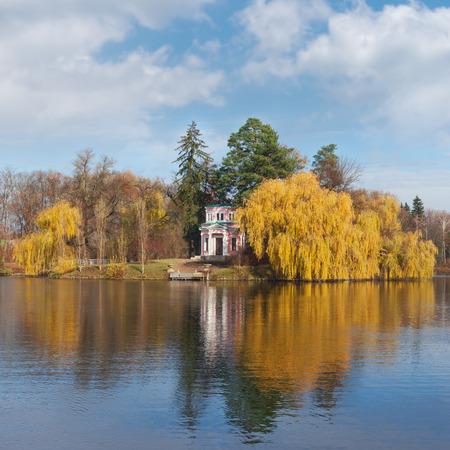 city park pavilion: Upper Pond and Pink Pavilion on Island of Anti-Circe in National dendrological park Sofiyivka.  Uman city, Central Ukraine Stock Photo