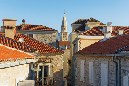stovepipe: Red roofs  with bell tower of  St. John Church. Old Town of Budva, Montenegro