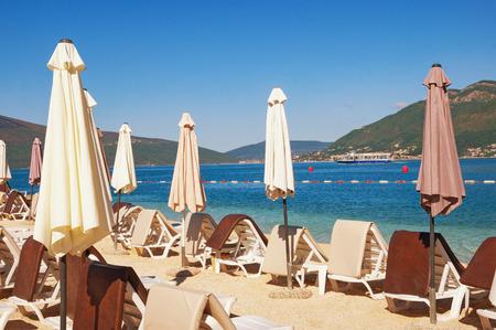 kotor: Beach on sunny summer morning. Bay of Kotor, Montenegro Stock Photo