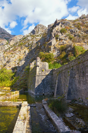 kotor: Skurda river and northern walls of the fortress of Old Town of Kotor, Montenegro, autumn