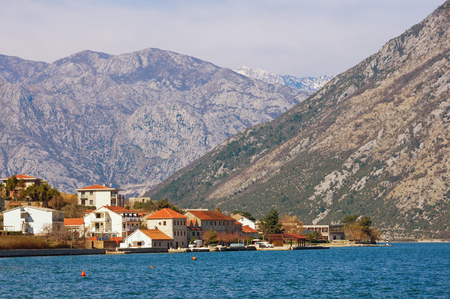 Small town at the foot of the mountains. Bay of Kotor, Prcanj, Montenegro