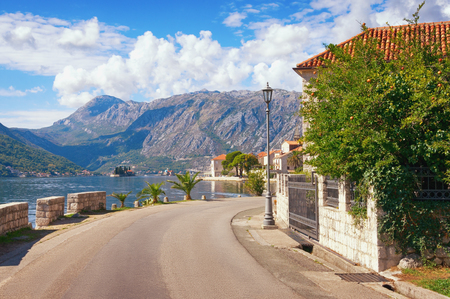 Road trip through the Balkans. View of seaside Perast town with islands of St. George and Our Lady of the Rocks , autumn, Montenegro