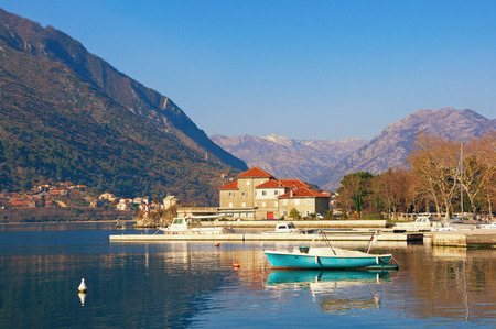 Sunny winter day in Montenegro. View of Bay of Kotor and building of the Institute of Marine Biology in Dobrota town Stock Photo