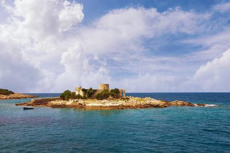 Ancient church on small island in Adriatic Sea.  Montenegro, Zanjice, monastery complex with the  church of Ascension of Virgin Stockfoto