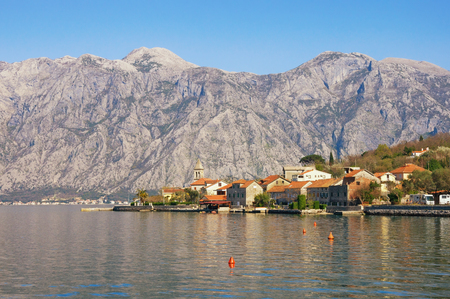 Sunny Mediterranean landscape.  Montenegro, view of  Bay of Kotor ( Adriatic Sea ) and seaside village of Stoliv