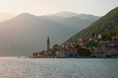 Beautiful evening Mediterranean landscape. Montenegro, Bay of Kotor, Adriatic Sea. View of ancient town of Perast  with bell tower of church of St. Nicholas