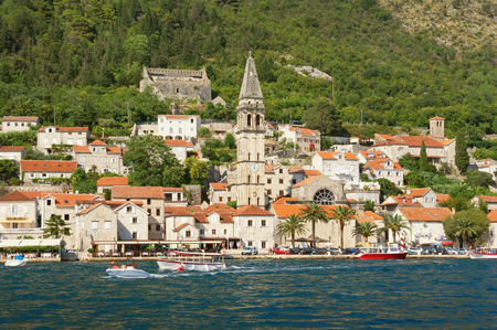 Summer view of ancient town of Perast with bell tower of St Nicholas church. Bay of Kotor, Montenegro