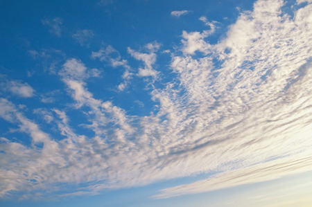 Blue sky and beautiful white clouds illuminated by the sun
