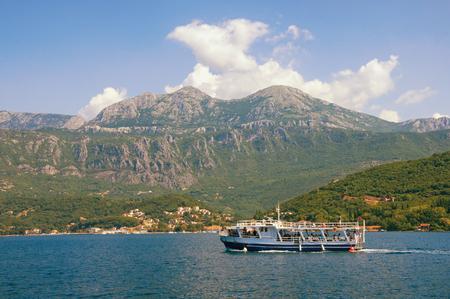 Summer Mediterranean landscape with pleasure boat.  Montenegro, Adriatic Sea, Bay of Kotor