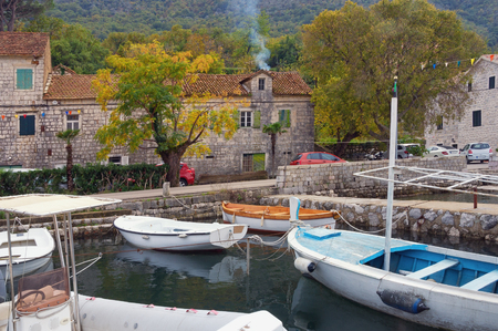 Autumn day in small Mediterranean town. Montenegro, Adriatic Sea, Bay of Kotor.  View of ancient town of Stoliv