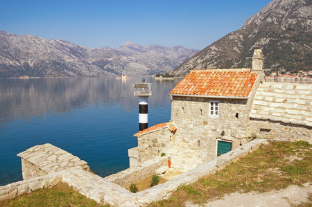 Beautiful Mediterranean landscape on sunny spring day. Montenegro, Adriatic Sea. View of Bay of Kotor, ancient Church of Our Lady of the Angels and two small islands (Our Lady of the Rocks and St. George)