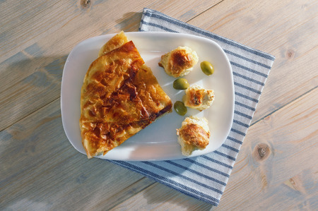 Balkan cuisine. Burek with cheese,  popular national dish.  Flat lay. White rustic background Imagens